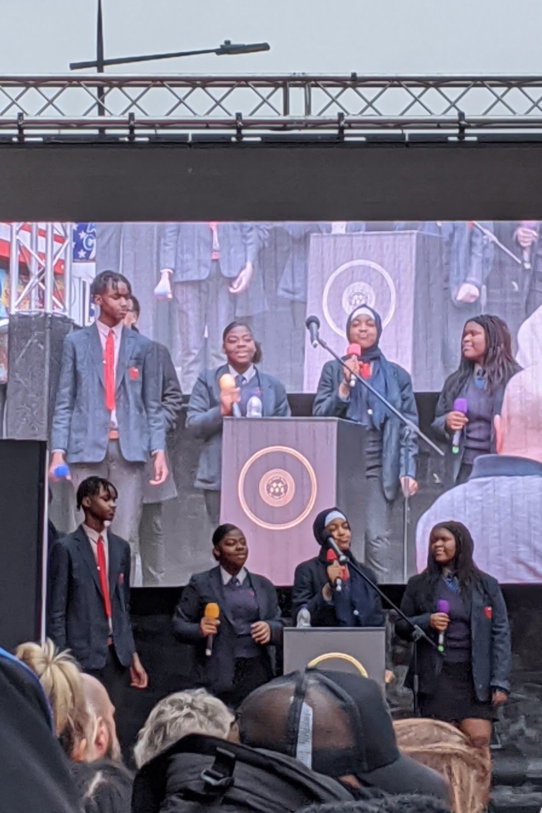 Four pupils from Camden's Haverstock School sing at the event.